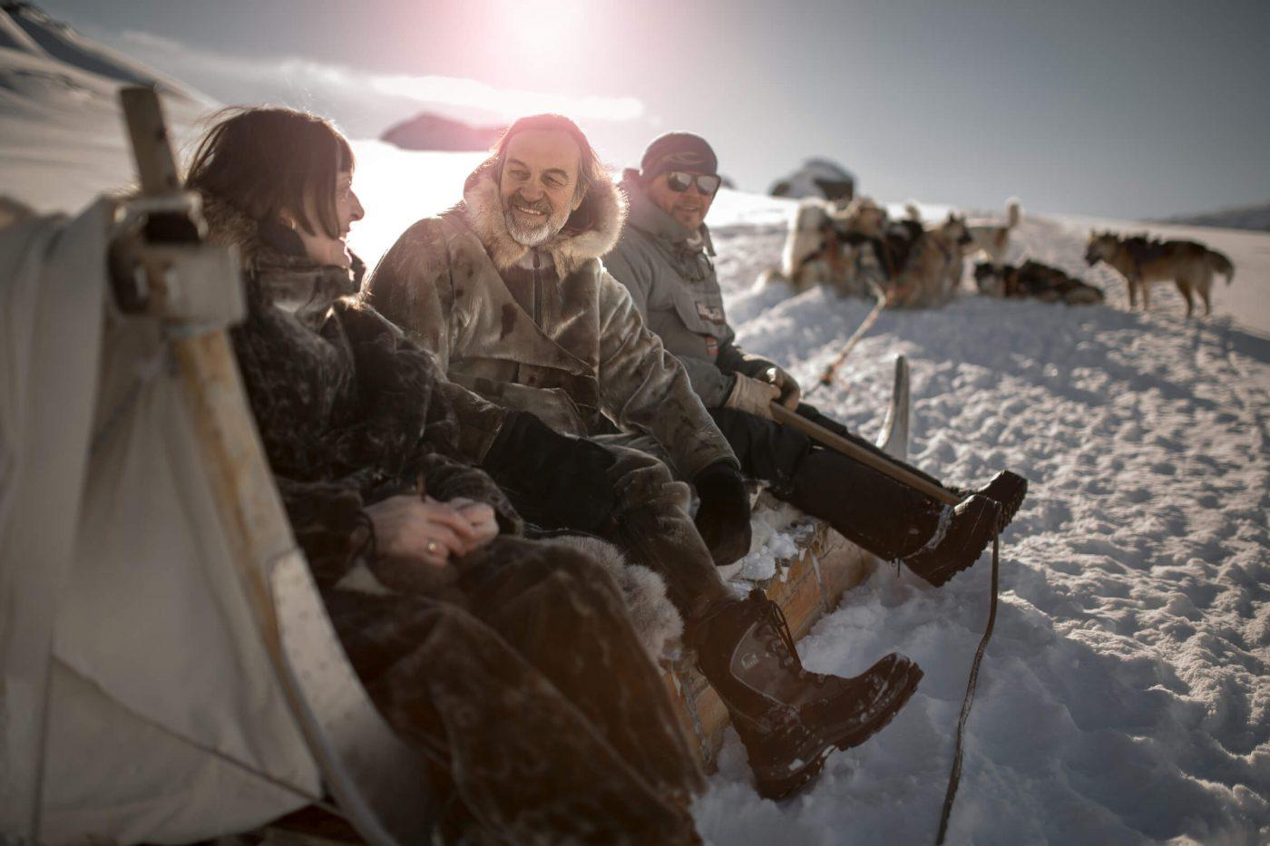 Passengers and driver on a dog sled near Sisimiut in Greenland
