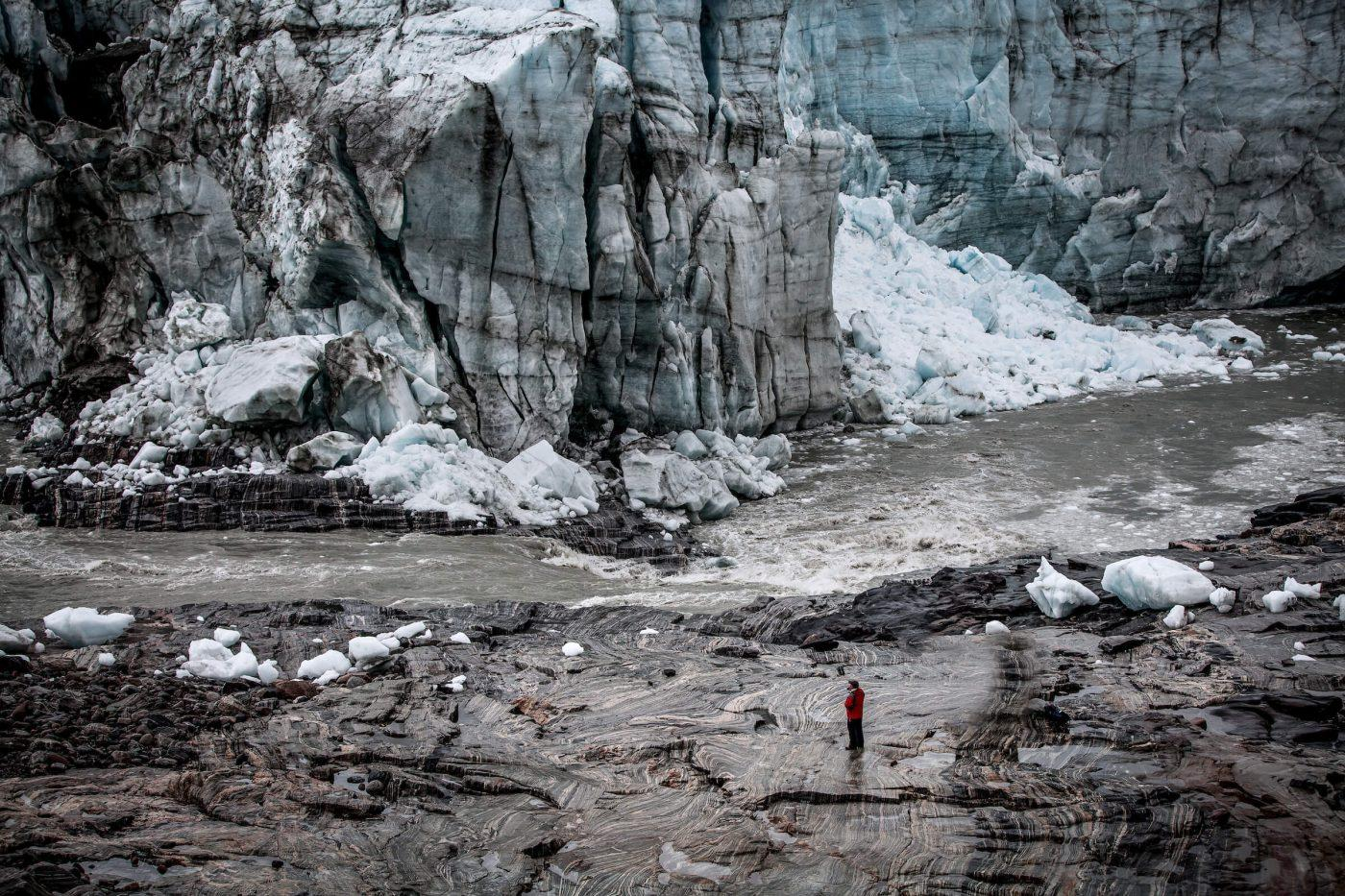 People are easily dwarfed by the size of the Russell Glacier wall near Kangerlussuaq in Greenland. Photo by Mads Pihl
