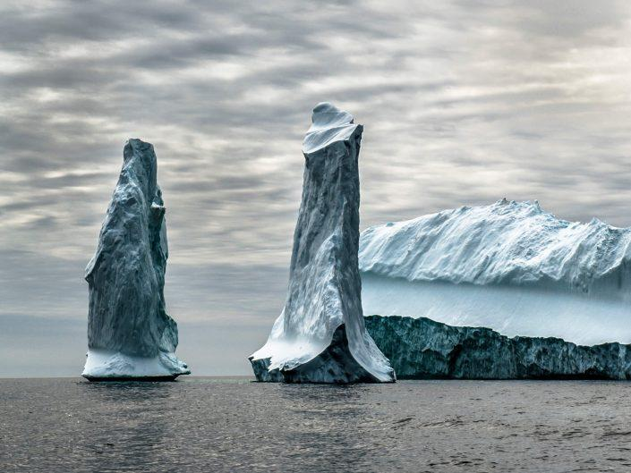 Pillars of ice in front of an iceberg in South Greenland, by Camilla Hylleberg