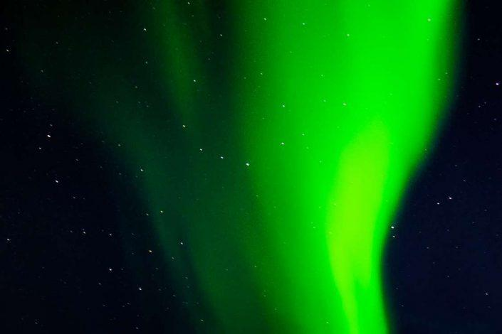 Green Northern Lights in East Greenland. Photo by Pirhuk - Greenland Expedition Specialists
