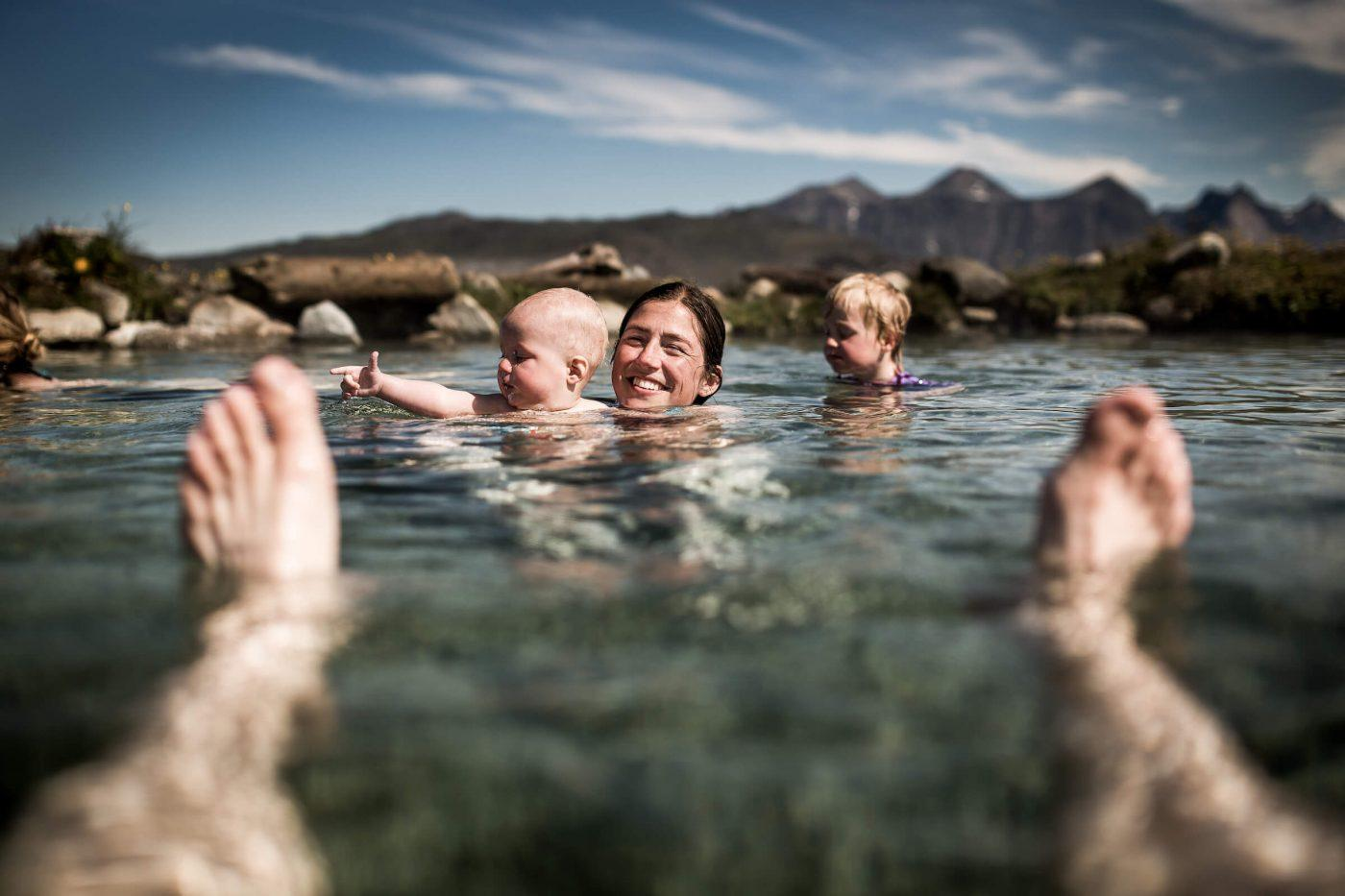 Relaxing at the hot pools of Uunartoq in South Greenland. By Mads Pihl