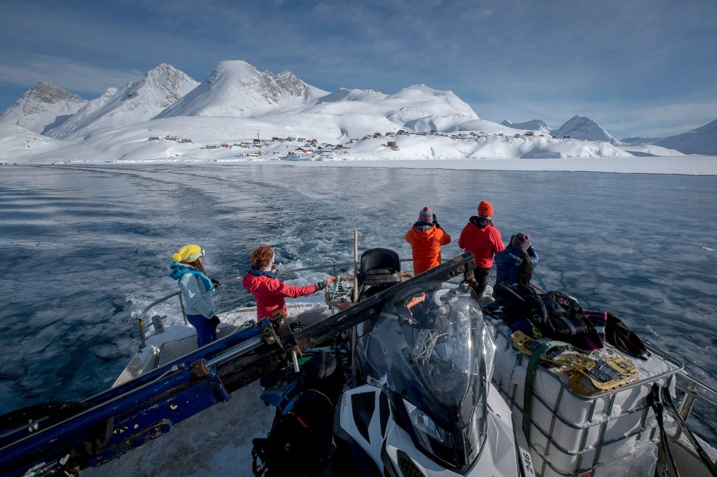 Skiers leaving Kuummiut on the Siggi Turs shuttle boat in East Greenland. Photo by Mads Pihl