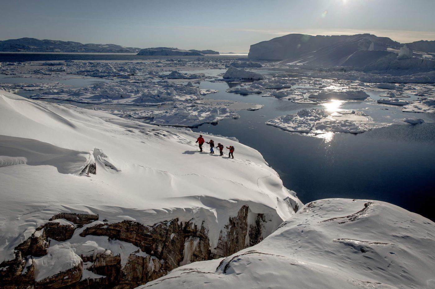 Snowshoeing near Sermermiut on the edge of the Ilulissat ice fjord in Greenland. Photo by Mads Pihl