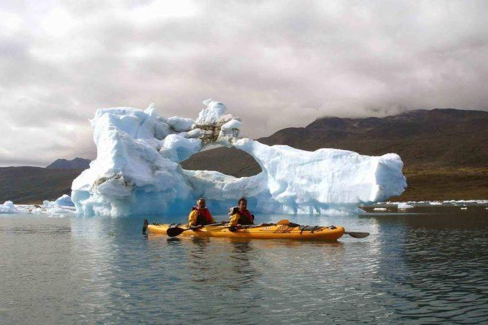 Two people kayaking among icebergs in South Greenland. Photo by Tasermiut South Greenland Expeditions, Visit Greenland