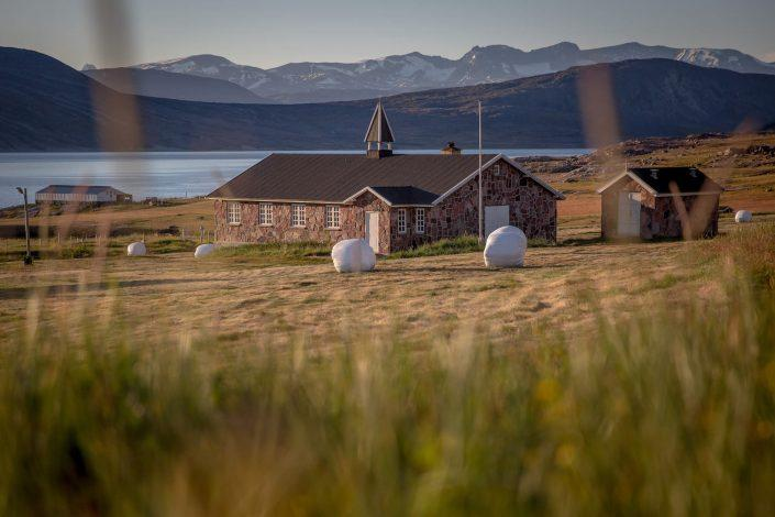 Sunrise over the church in Igaliku in South Greenland. By Mads Pihl
