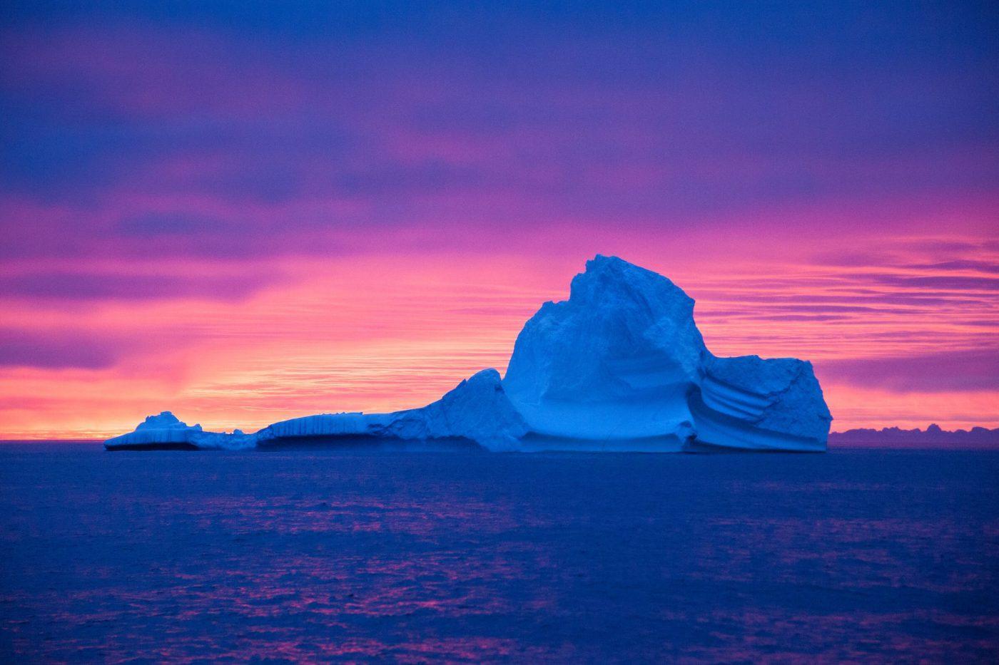 Sunset behind icebergs. By Glenn Mattsing