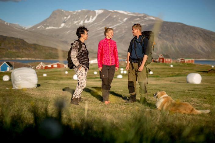 The guests talking in a field in Igaliku in South Greenland. By Mads Pihl