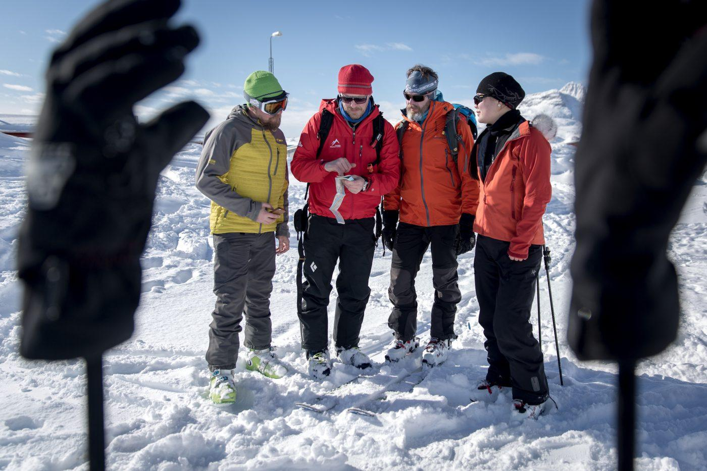 The guide preparing the group for ski touring in Kuummiut in East Greenland. By Mads Pihl