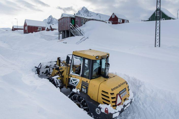 The local bulldozer digging through mountains of snow in Kuummiut in East Greenland. Photo by Mads Pihl