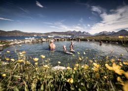 The Uunartoq hot springs in South Greenland enjoy a great view of icebergs and mountains. By Mads Pihl
