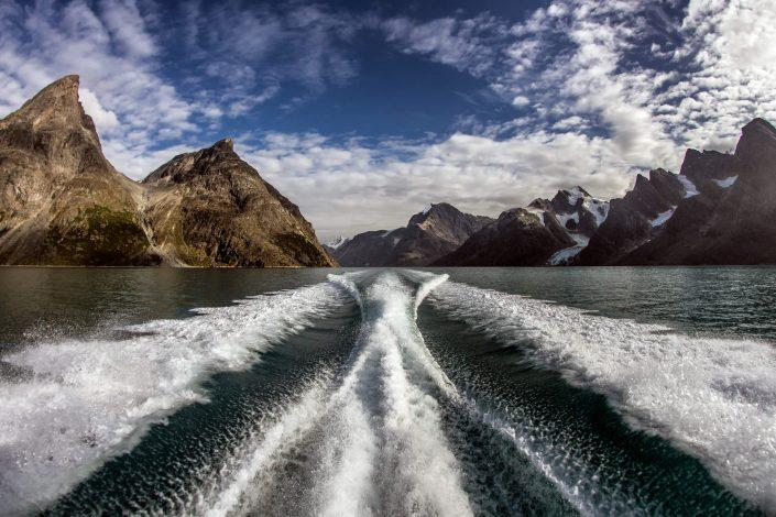 The wake of Maniitsoq Tour Boat -Matta- in the Eternity Fjord in Greenland
