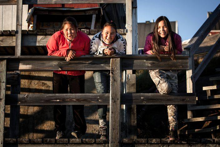 Three girls from Kangaamiut in Greenland. Photo by Mads Pihl