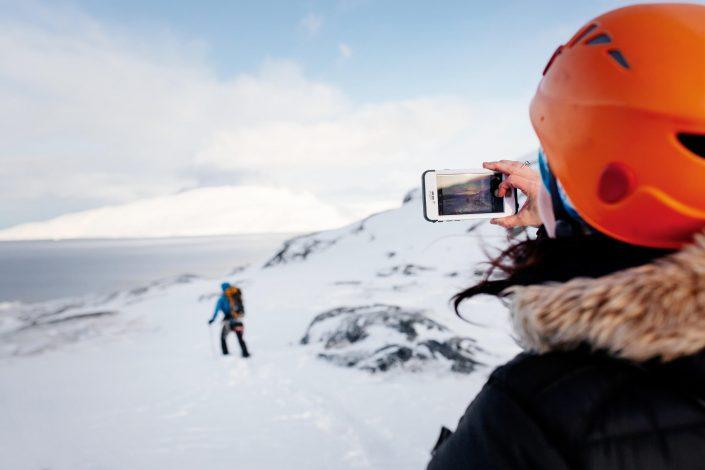 Tourist taking a photo of Marc Carreras in back-country Nuuk in Greenland. By Rebecca Gustafsson