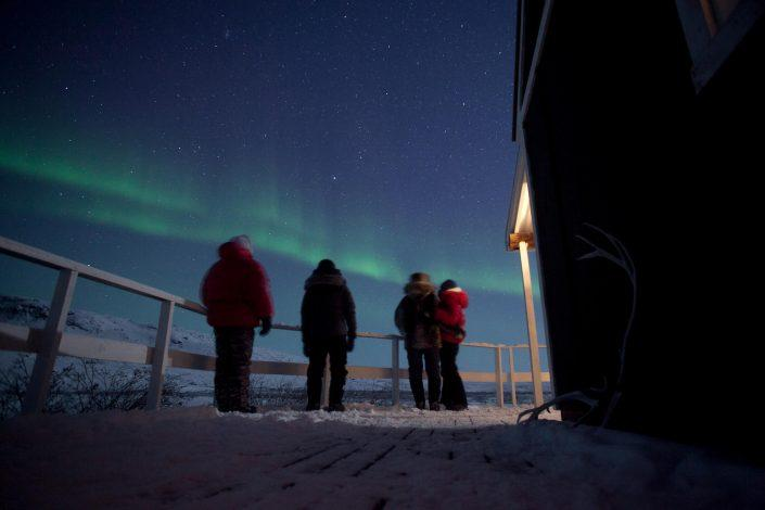 Travelers under the nothern lights near Kangerlussuaq in Greenland. Photo by David Trood