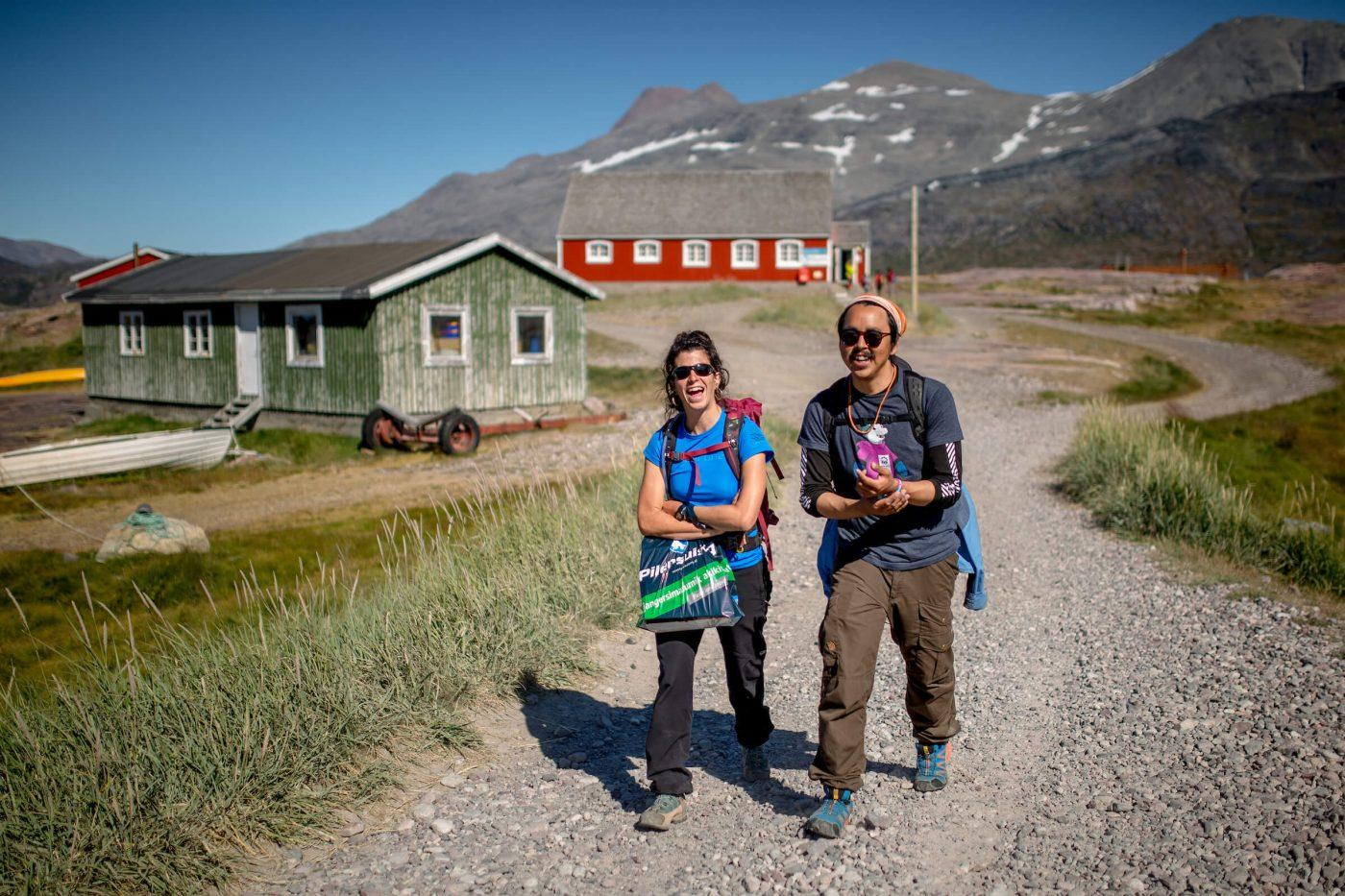 Travelers walking from the shop in Igaliku in South Greenland. By Mads Pihl