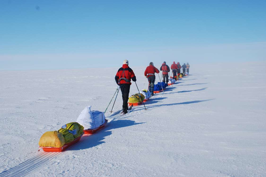 A group of skiers making their way to set up their new camp. Photo by Arctic Dream, Visit Greenland