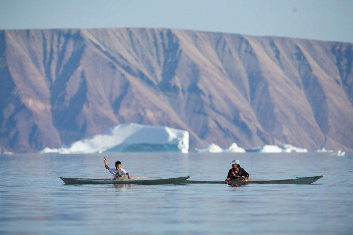 Two boys in Inuit kayaks, Qaanaaq. By Glenn Mattsing