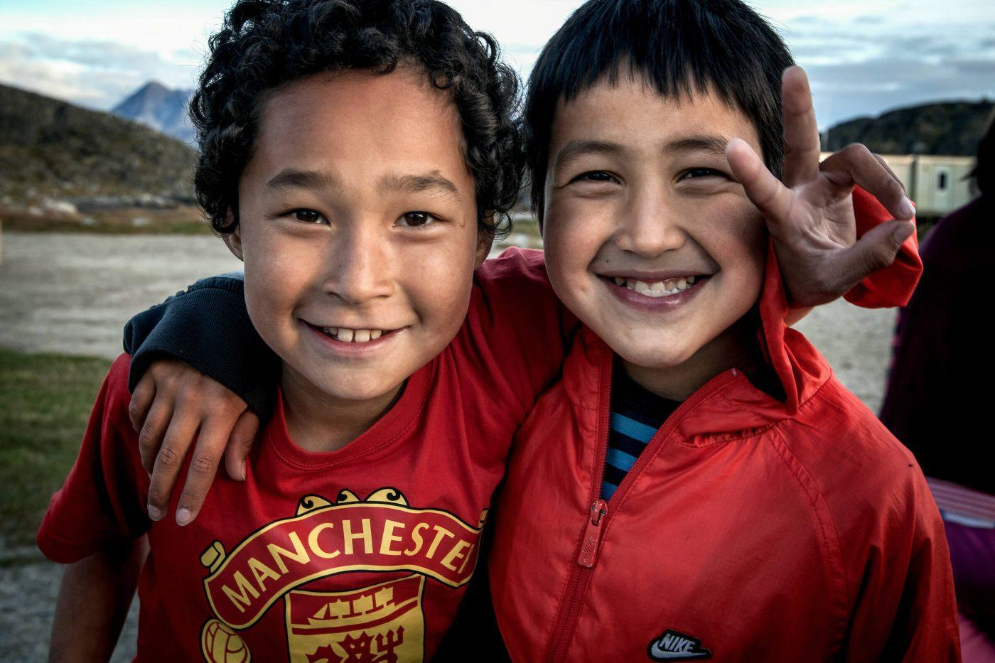 Two football loving kids from Itilleq in Greenland, by Mads Pihl
