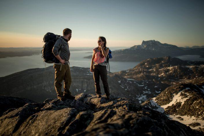 Two hikers in the midnight sun on Ukkusissaq - Store Malene outside Nuuk in Greenland. By Mads Pihl