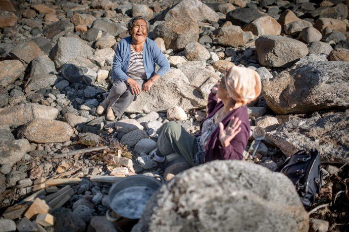 Two women having fun while cooking in Narsaq in South Greenland. Photo by Mads Pihl